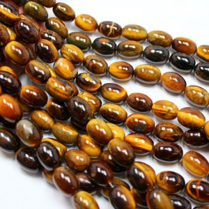 300CTS-1 STRAND TIGER EYE 14 X 10 MM 16 INCH 12 U$ Per Carat
